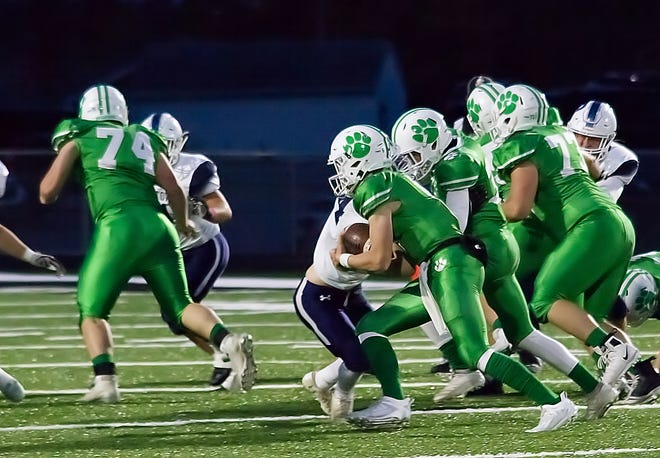 Mogadore Quarterback Will Butler keeps the ball for a strong gain during the second quarter behind the blocking of Collin Rogan (74).