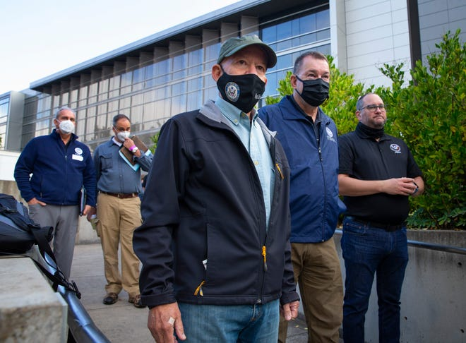 Rep. Peter DeFazio and FEMA Administrator Pete Gaynor gather at the University of Oregon on Saturday for a disaster briefing for local officials in the wake of wildfires in Oregon.