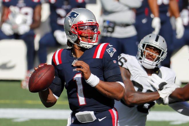 New England Patriots quarterback Cam Newton looks to pass during last week's win over the Las Vegas Raiders.