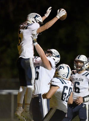 Fairless receiver Conner Durant celebrates a touchdown against Tuslaw in the first half.  (IndeOnline.com / Kevin Whitlock)