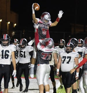 Sandy Valley's Ben Petro (5) — being held up by teammate Wyatt Moyer after scoring against Tusky Valley on Oct. 2, 2020 — scored one of his team's three defensive TDs Saturday night in a rout of Tuslaw. (Special to The Canton Repository / Bob Rossiter)