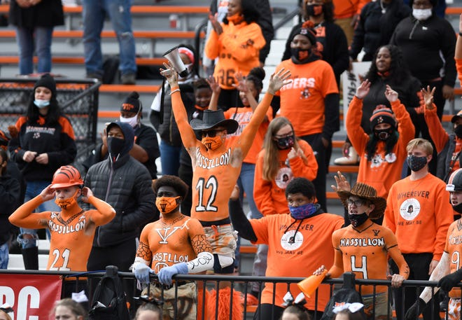 Massillon students cheer during the Tigers' win over McKinley on Saturday, Oct. 3, 2020.