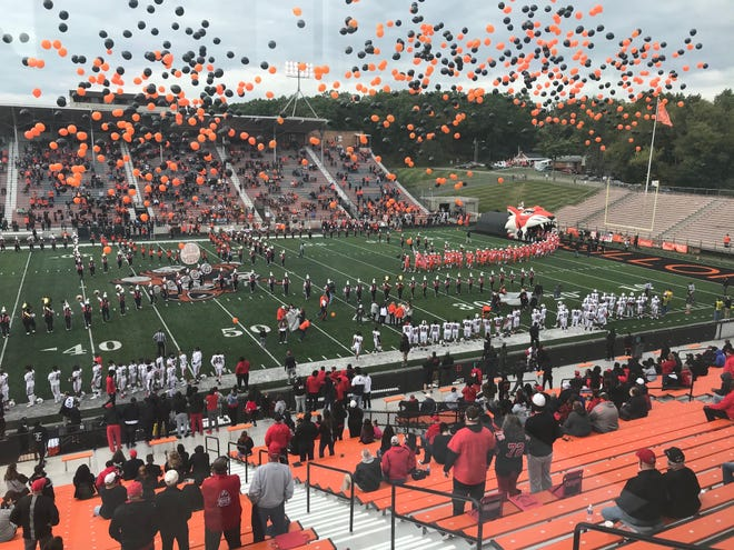 Balloons fly during the pregame of the Massillon-McKinley rivalry football game Saturday at Paul Brown Tiger Stadium. Only 1,776 fans were able to attend due to the coronavirus pandemic.