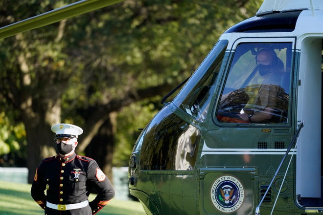 The pilot of Marine One wears a face mask as President Donald Trump prepares to leave the White House to go to Walter Reed National Military Medical Center after he tested positive for COVID-19, Friday, Oct. 2, 2020, in Washington. (AP Photo/Alex Brandon)