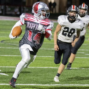 Sandy Valley's Mason Tucci caught passes that helped quarterback Cam Blair break Stark County records for career touchdown passes and passing yards.