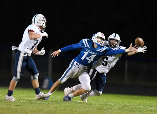 Tuslaw's Kaden Lau (14) tries to break up a pass intended for Fairless' Conner Durant during the Mustangs' Week 6 game.  (IndeOnline.com / Kevin Whitlock)