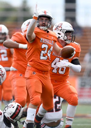 Massillon's Nick Liebler signals to the goal line after a big gain against McKinley Saturday October 3rd 2020.