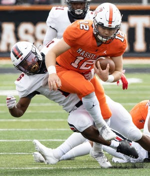 Massillon's Zach Catrone tries to step through the tackle of  McKinley's Mani Powell Saturday, Oct. 3, 2020. (Special to The Canton Repository / Bob Rossiter)