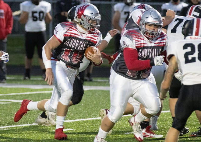 Sandy Valley's quarterback Cameron Blair rushes for a touchdown behind blocker Wyatt Moyer during the first quarter of a game against Tusky Valley this season.