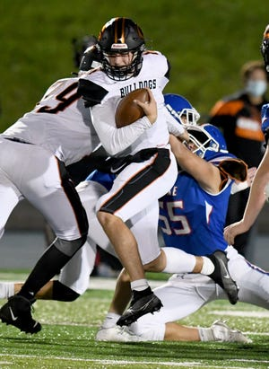 Quarterback Trevor Van Horn is brought down in the second quarter of Green's game at Lake on Oct. 02, 2020.