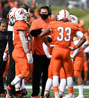 Massillon coach Nate Moore talks with his team during its win over McKinley on Saturday.