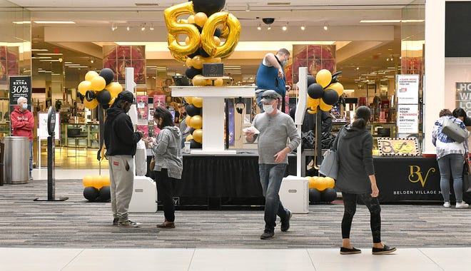 Belden Village Mall celebrated its 50th anniversary Saturday with Mobile Jams Entertainment playing '70s tunes in Center Court, a '70s-themed trivia contest, free cookies, photos with the special 50th anniversary logo and 50 gift bags given away throughout the day. The mall opened on Oct. 1, 1970.