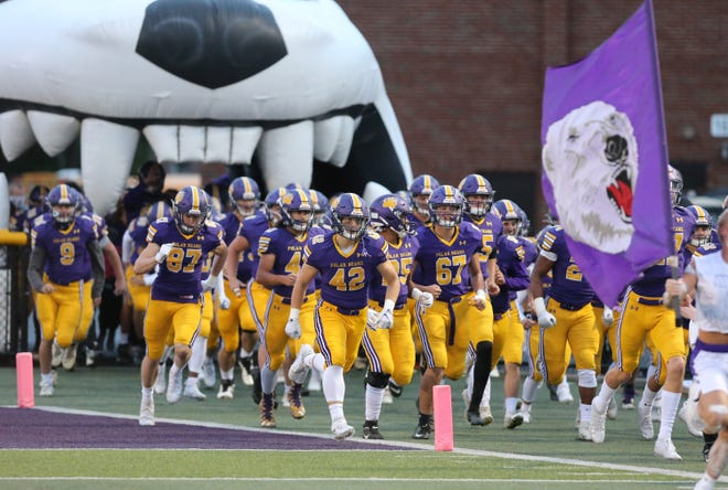 The Jackson Polar Bears rush onto the field against rival Hoover on Oct. 2, 2020.