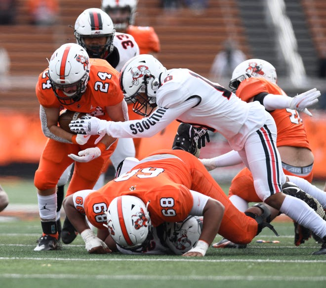 Massillon's Terrence Rankl (68) pancakes a McKinley defense to open up a hole for Nick Liebler during the teams' Week 6 game.