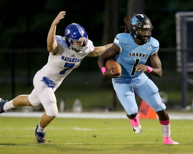 Ponte Vedra quarterback Jacobi Myers(1) is chased by Matanzas defensive end Casey Hamilton (7) in the second quarter of an Oct. 2, 2020 football game in Ponte Vedra Beach.