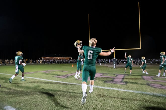 Fleming Island quarterback Grant Travis (6) and teammates race across the field in celebration after defeating Creekside last week.