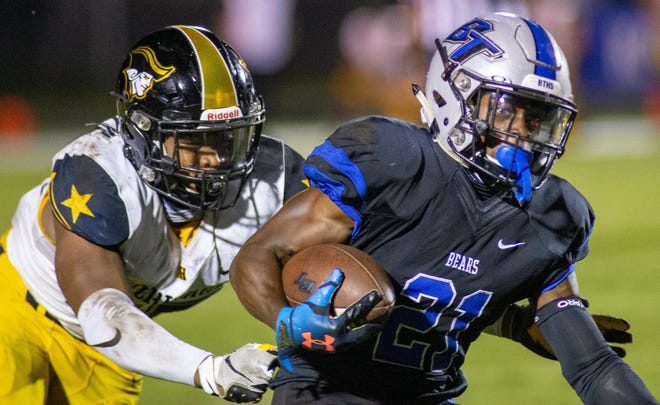 Bartram Trail athlete Eric Weatherly squirts out of the grasp of an American Heritage defender during the second quarter of an Oct. 2, 2020 game. Weatherly had 193 all-purpose yards against the Class 5A state champions.