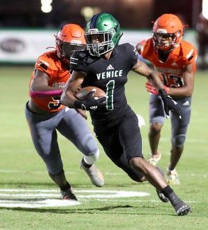 VeniceÕs Jayshon Platt (1) runs for a touchdown against Sarasota during Friday night football action in Venice. ( Herald-Tribune photo / Matt Houston )