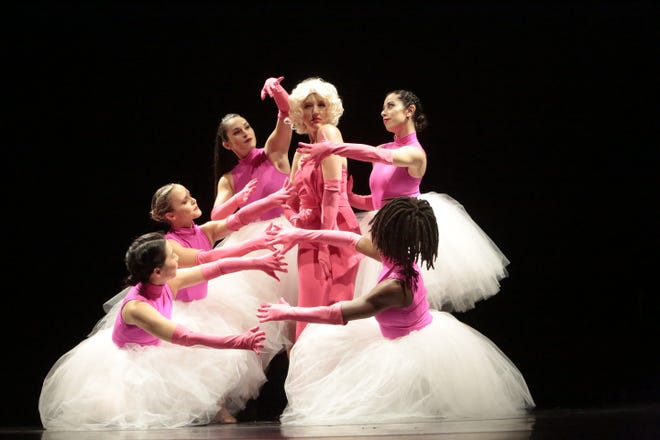 "Jessica Obiedzinski as Marilyn Monroe, surrounded by the members of Sarasota Contemporary Dance, in resident choreographer Erin Fletcher's ""The Unofficial Biography of Marilyn Monroe."""