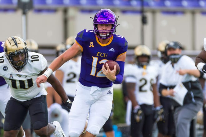 ECU's Holton Ahlers runs the ball against UCF on Sept. 26 at Dowdy-Ficklen Stadium.