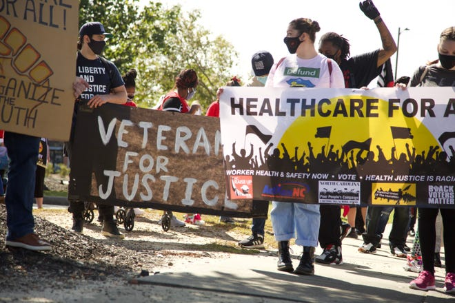 Several organizations from across the state held a 'Medicaid for All' march in downtown Fayetteville on Saturday. Their primary message was 'health care for all.' [Sharilyn Wells for The Fayetteville Observer]