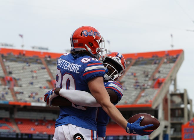 Trent Whittemore, left, and Justin Shorter celebrate a touchdown for the Florida Gators against South Carolina on Oct. 3 at Ben Hill Griffin Stadium.