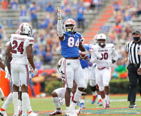 Florida tight end Kyle Pits (84) signals a first down after making a catch during a game against South Carolina at Ben Hill Griffin Stadium, in Gainesville, Fla. Oct. 3, 2020.