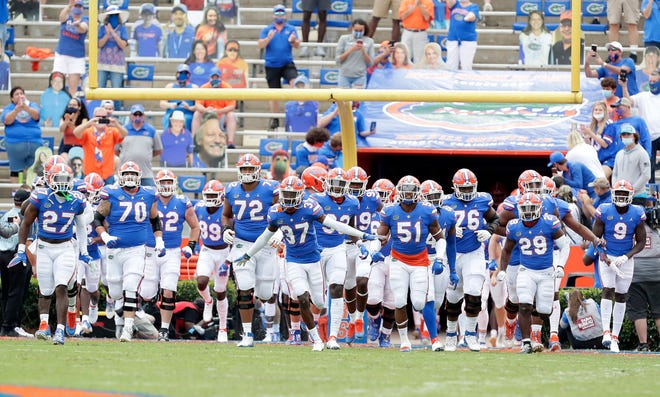 Gators players run out of the tunnel at the start of Saturday's victory against South Carolina.