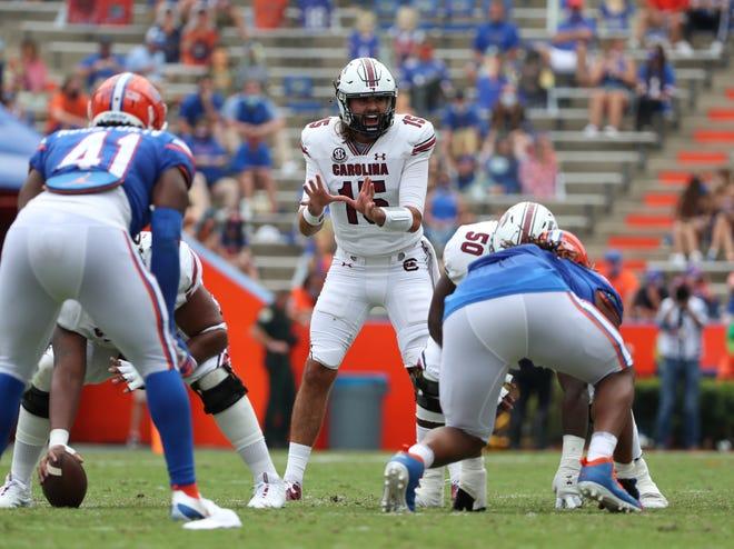 South Carolina quarterback Collin Hill awaits the snap Saturday against Florida at Ben Hill Griffin Stadium.