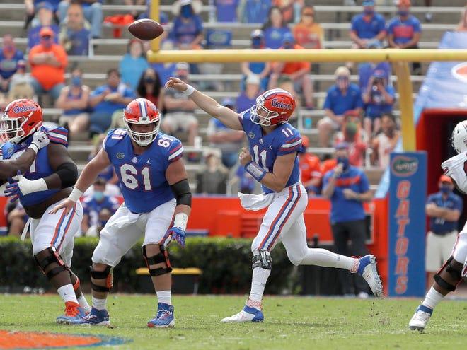 Florida quarterback Kyle Trask throws Saturday against South Carolina at Ben Hill Griffin Stadium.