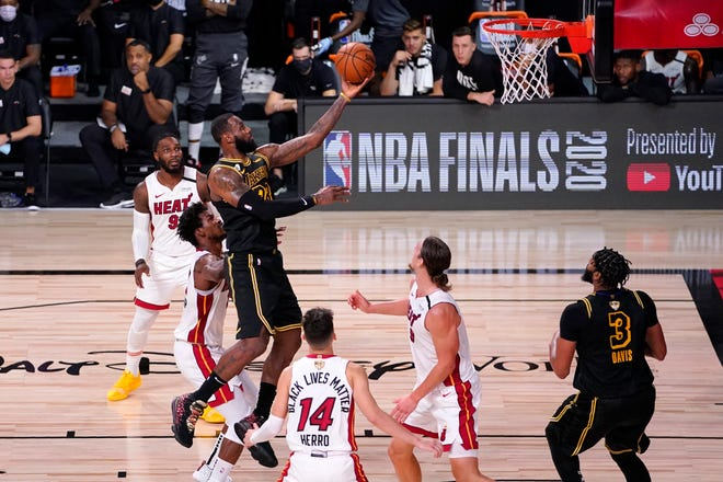 LeBron James and the Lakers needs just two more win to capture the franchise's 17th NBA champion against Jimmy Butler and the resilient Heat. MARK J. TERRILL/AP