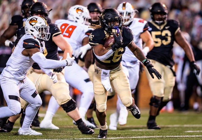Wake Forest running back Christian Beal-Smith picks up yards against Campbell on Friday night.