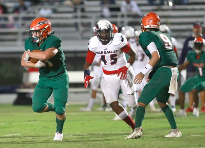 Mosley's Hunter Burke carries the ball during a game against Wakulla on Oct. 2, 2020 at Arnold. The Dolphins' next  game against Niceville, originally scheduled for Friday, has been moved up to Thursday in Niceville at 6 p.m. due to weather concerns as a result of Hurricane Delta.