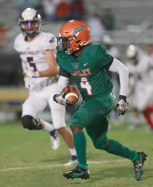 Mosley's Trey Johnson (4) runs the ball. Mosley faced off with Wakulla for a football game on Oct. 2, 2020 at Arnold.