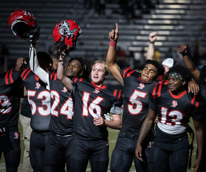 Bay High players celebrate with the singing of their school anthem after a win over the Marlins. Arnold High School faced Bay High at Tommy Oliver Stadium Friday, October 2, 2020.