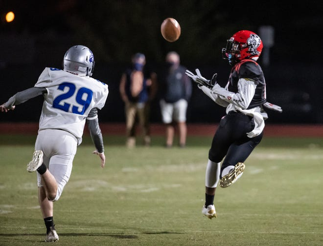 Bay High's Jacques Lee pulls in a touchdown pass on the opening drive against the Marlins. Arnold High School faced Bay High at Tommy Oliver Stadium Friday, October 2, 2020.