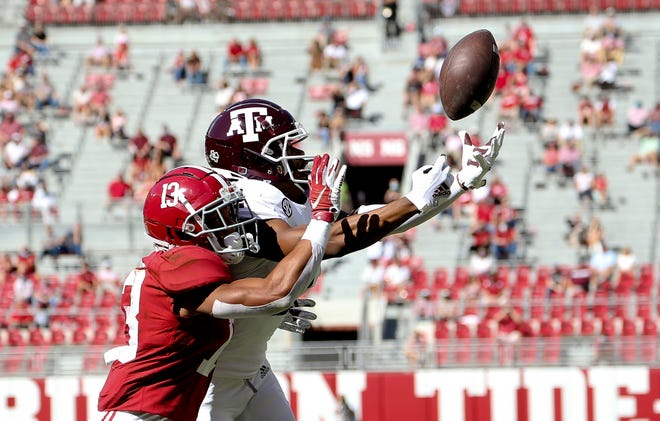 Oct 3, 2020; Tuscaloosa, Alabama, USA; Texas A&M wide receiver Chase Lane (2) can't reach a pass with Alabama defensive back Malachi Moore (13) defending at Bryant-Denny Stadium. Mandatory Credit: Gary Cosby Jr/The Tuscaloosa News via USA TODAY Sports