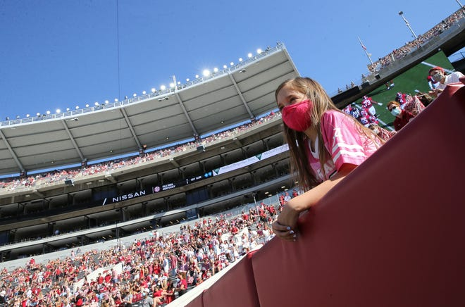 Lilah Inman wears her mask as she watches Alabama play Texas A&M at Bryant-Denny Stadium on Oct. 3.