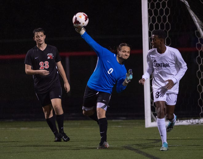 South goalie Isaac Smith clears the ball while teammate Milo McNabb (left) and Central's Abdi Mohamud look on during their game Sept. 28. The host Wildcats won 1-0 to snap a 13-game winless streak against the Warhawks. South's previous win in the series was 2-1 on Aug. 30, 2007.