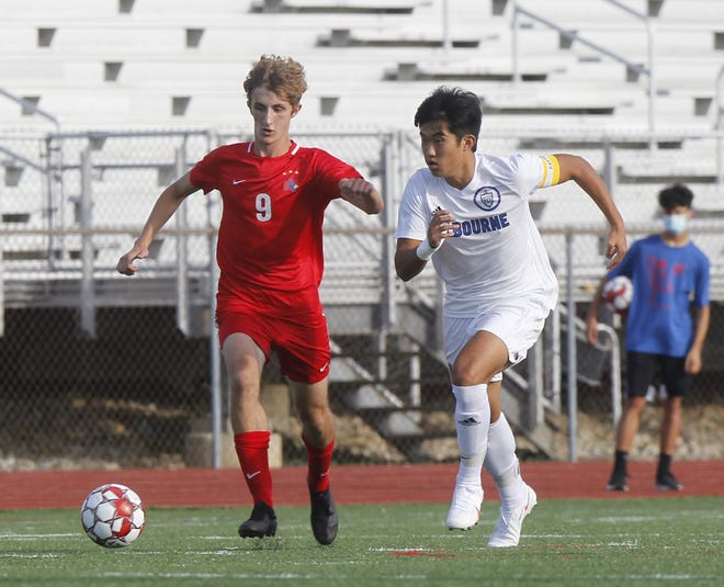 "Kilbourne's Brandon Kim takes on Thomas' Graham Werbovetz during their game earlier this season. Kim, a four-year starter, has played a key role in the Wolves becoming a central Ohio power. ""He's kind of a quiet guy, but everybody knows he's a leader and everybody follows him,"" senior goalie Tyler Katz said."