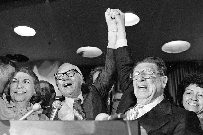 In this June 7, 1978, file photo, Howard Jarvis, right, and Paul Gann celebrate as their co-authored initiative Proposition 13 takes a commanding lead and ultimately won in the California primary in Los Angeles.