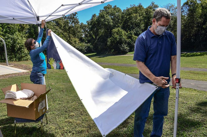Zoe Hale, left, coordinator for the Anderson County Complete Count Committee for Census 2020, and Dave Phillips help break down the information tent after the Fired Up and Ready to Vote event at Greeley Park in Anderson Saturday, October 3, 2020.  I Am Strong Dance Company, Anderson County NAACP, New Beginning Ministries, and Anderson County Voter Action Committee were at the event with free food and drinks, encouraging people to vote.