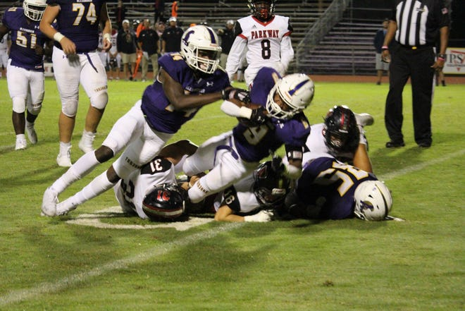 ASH running back Jarvis Newton (9) powers his way in for a touchdown during Friday's game against Parkway.
