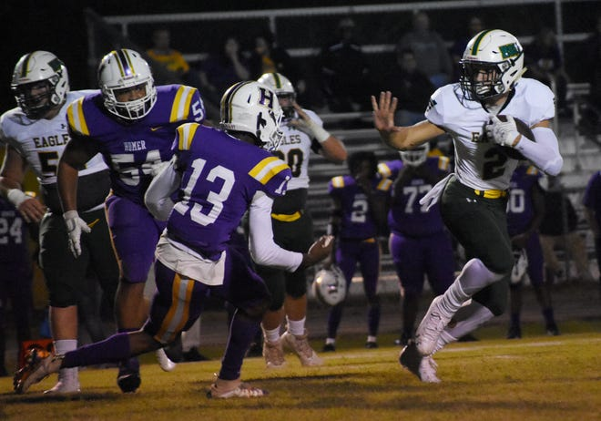 Holy Savior Menard's Brayden Byers (2) flashes a stiff arm to Homer's defense Friday, Oct. 2, 2020.