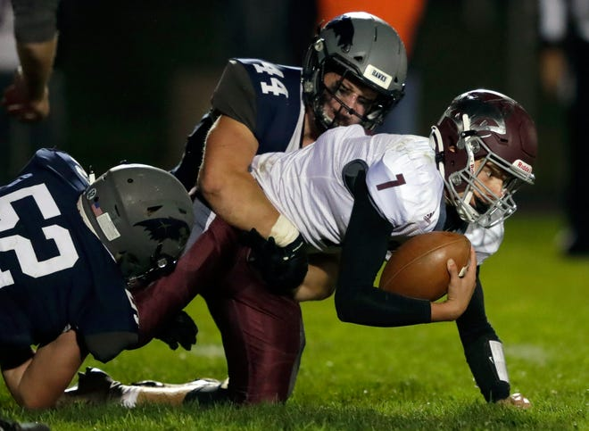 Xavier's Mac Strand (44) sacks Fox Valley Lutheran quarterback Drew Mears during their football game Oct. 2 at Xavier High School. Strand has been voted first-team all-state by the Associated Press.