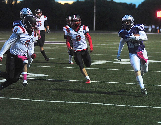 Seth Vizzo (33) runs for a first down, avoiding Orrville defenders during the Titans' 13-6 win over their rival.