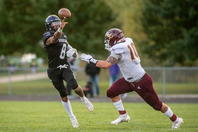 Lakeview senior Jaden Simonson (8) passes the ball as Kalamazoo Central junior Joshua Boggan (10) covers him on Friday, Oct. 2, 2020 at Lakeview High School in Battle Creek, Mich. Lakeview defeated Kalamazoo Central 28-12.