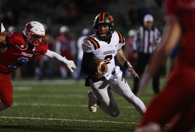 Ridgewood's Gabe Tingle eludes a Garaway defender in a game earlier this season. Tingle was named the Tribuneland football player of the year.