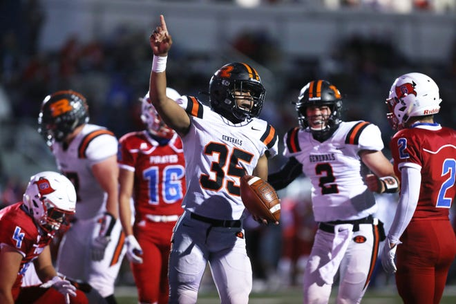 Ridgewood's Deontae Brandon celebrates after scoring against Garaway Friday night in Sugar Creek. The General's beat the previously undefeated Pirates to claim the IVC South title.
