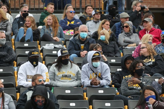 Fans watch action between Adrian College and Trine University, Saturday, October 3, 2020 at Docking Stadium in Adrian, Michigan.